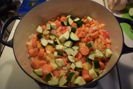 THEN THE SQUASH, ZUCCHINI, CARROTS AND POTATO GET TOSSED INTO THE MIX.